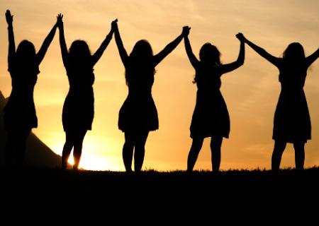 five women celebrating chakra healing
