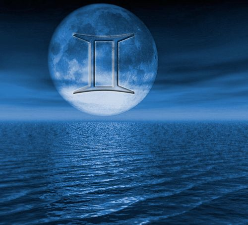 full moon over water with gemini symbol
